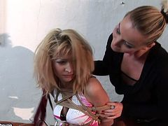 Fuckable blond MILF sits on the bed bandaged by pitiless mistress before she starts slapping her cuddly body with a lash in sizzling hot BDSM sex video by 21 Sextury.
