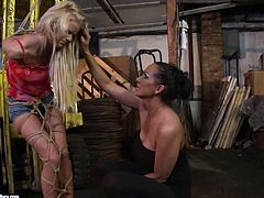 Nasty blonde wench is tied up with her hands locked behind her back. She is unable to make a single move without approval of her mighty mistress. Watch her getting humiliated and punished bad by tough woman.