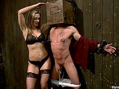 Busty blonde dominatrix Tanya Tate is having fun with some guy indoors. She pulls him by the dick and fucks his ass with a sex machine and they both enjoy it much.