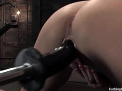 Hot brunette chick spreads her sexy legs and gets her wet pussy toyed by the fucking machine. In the end she squirts and licks the dildo.
