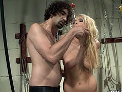 Blonde nympho gives her bondage master a nice blowjob
