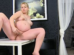 Chubby pregnant blonde shows her nice ass