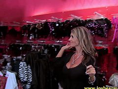 Michelle Moist is out shopping with a hot friend of hers. They go to a lingerie shop and get horny, so they each other's cunts and use a new toy they bought.