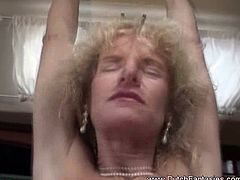 This blonde granny from the Netherlands has her ass hole and cunt fucked with her sexy lingerie on.