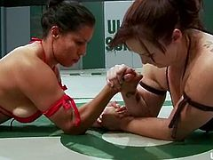 Two passionate brunette girls wrestle in the ring and Bella Rossi loses. So, she has to lick some Latin pussy and after that she gets toyed with a strap-on.