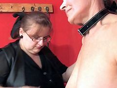 BBW dominatrix plays with two submissives
