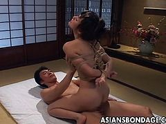 Asian babe in bondage forced to fuck