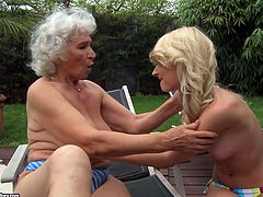 This old woman knows what she wants and does a fine job of getting it. She spreads her legs wide to let young lesbian lick her hairy snatch.