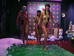 Our ladies are almost naked and pour a lot of oil in the middle of the Morning Show studio. Why? Well these girls are not allowed to ice skate naked so why not do it in our studio, but on oil! Isn't this nice? Look like all those hot thighs, naughty cunts and sexy tits. Enjoy our special X-mass episode!