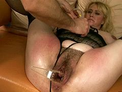 Damn, that hairy pussy of hers is fucking disgusting! Spoiled woman spreads her legs wide to get her pussy stretched with a vaginal speculum.