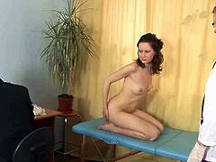 Check out this cute brunette teenie opening her long legs for these horny doctors. She wants to get her pussy examined and is ready to cum from the fingering!