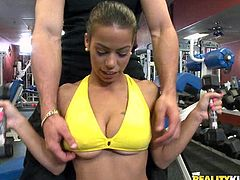 Bitch is lifting some weights at the fucking gym and shows off her big-ass tits, hit play and check it out right here! It's fucking cool.