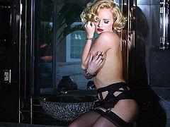 Hot blonde Playboy model makes great erotic show. She demonstrates her beauty and gracefulness. This babe also fondles her nice titties.