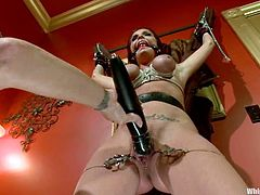 Submissive brunette chick gets tied up by her nasty mistress. Then she also gets her pussy gaped with claws. After that she also gets toyed with a strap-on.