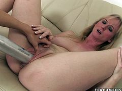 This blonde whore is damn proud of her pussy. She lets her lesbian friend stretch her snatch with a baseball bat. Then she gets her wet fanny fisted properly.