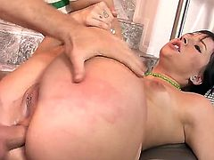 Young black haired slut Ashli Orion with natural tits and pierced thong polishes shaved pink cunny while tattooed stud is drilling deep her big bouncing ass in missionary position.