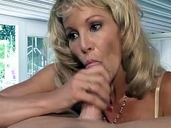 Lustful blonde woman shows her love for sucking dicks. She gives an amazing blowjob to a barman and gets facialed.