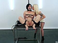 This sizzling brunette chick is being lured and seduced for some fetish action! Lorelei Lee is her mistress for today and she will painsult Belle Noire!