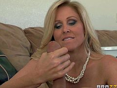 Julia Ann is one good looking mature blonde with perfect huge tits. She gives sex instructions to her step-son Jessy Jones. She lets him lick her sweet bald pussy and sucks his dick before she gets fucked.