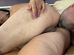 Flamboyant mature BBW rides a massive cock of young lover reverse before she lies in sideways pose to get her hairy cunt drilled hard from behind.
