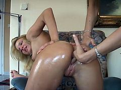 Adorable blonde babe strips her clothes off and gets her ass oiled up by the girl. Later on Gabi also gets her pink pussy fingered.