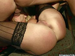 Playful blond hottie in black lacy stockings gets her fresh pink pussy toyed with a dildo before a kink dude starts fisting it rapaciously in BDSM involved sex video by 21 Sextury.