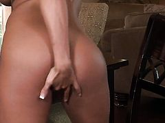 Nicole Graves with huge hooters and bald bush screams as she fucks herself with toy