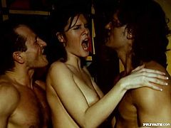 Sexy slim brunette Jennifer Dark is playing dirty games with two studs in a dark room. She sucks their pricks ardently and then enjoys a terrific DP in standing position and gets facialed.