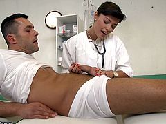 Beefy dude gets seduced by fuckable brunette doctor. She inclines to his massive cock to suck it zealously before remembering to lick his full balls in steamy sex video by 21 Sextury.