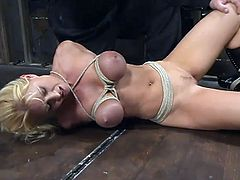 Curvaceous blonde chick gets tied up and clothespinned. Later on the guy puts a stocking on her head and toys the pussy with a vibrator.