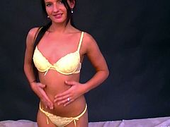 Mesmerizing brunette student takes part in a casting for porn movie. First she poses wearing tempting yellow lingerie before she is urged to go down to give a head to kinky dude.