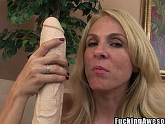This kinky blonde slut loves stretching out her vagina. She takes out a massive pair of dildo and fucks herself silly. She gets a two foot long black dildo lodged inside her vagina. What a dirty, dirty slut she is.