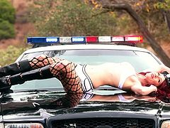 Hey you police officers, any problems? Elle Alexandra is a damn sexy law enforcement officer and she will show it on the hood of patrol car!