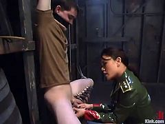 This dude gets tied up and clothespinned by Annie Cruz. Then she pinches his balls with mousetraps and toys the ass.