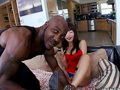 Petite Asian bitch Marica Hase is having fun with a bulky black stud. They caress each other passionately and then fuck doggy style and in other positions.