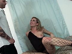 Kinky blonde chick with many tats on her body masturbates using various sex toys. Then, horny guy with small cock thrusts his tool in her mouth so she sucks it like lollicock. After stout blowjob they fuck missionary style.