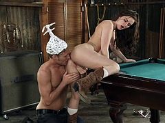 This stupid dumb fucker is wearing a tin foil hat, to protect his brain from aliens, but that won't stop him for having sex. He fucks her from behind, against the billiard table and then, kisses her cute butt.