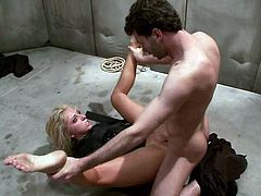 Beautiful blonde girl sucks two big dicks. Then these dudes put the straight jacket on her. Later on she gets her pussy fucked rough.