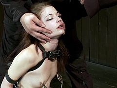 Cute petite brunette Sensi Pearl is having fun with some guy in an underground. The man chains the girl and then stuffs her tight coochie with a dildo.