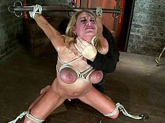 Charisma Cappelli gets mouth-fucked while having ropes on her tits