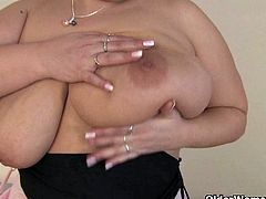 BBW Marie lets her natural big tits hang free and gives herself a good fuck with a dildo. She sticks it deep into her fat cunt in various positions and moans loud!