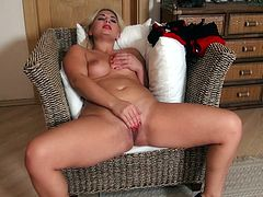 Bosomy blond bombshell strokes her cuddly body before giving blowjob