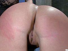 Slave is oiled up and chained so that her pussy is open