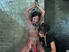 Nice brunette chick in some sort of school uniform gets tied up and undressed by a teacher. Later on Alyssa gets her pussy toyed deep with an electric dildo.