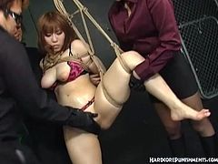 Two masters tied up a sexy Japanese and suspended her in the air. Then, they started to play with her hairy pussy by putting toys inside her dripping wet hole.