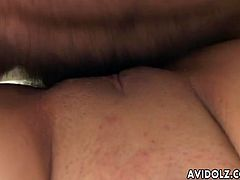 Cute and charming Asian pornstar Junna Aikawa on her knees taking two mushroom heads in her mouth and wanking it  with her hands to make it hard enough before banging and plowing her muff pie.