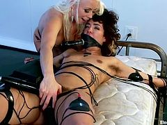 Brunette chick lies on a bed being tied up by her blonde mistress. Later on this brunette gets her vagina wired and toyed with a vibrator.