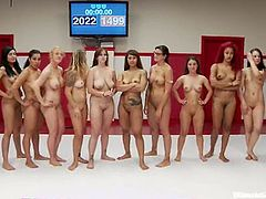 Busty chicks make an amazing catfight show. They fight in front of a public and then start to play with each others pussies.