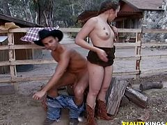 Jamie Elle is at a ranch and in there she's going to have fun with a cowboy, as this guy is going to bang her pussy and asshole outdoors.