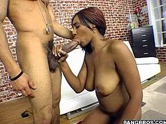 Dude gets his dick sucked by a horny ebony slut and then she takes it balls deep into her fucking